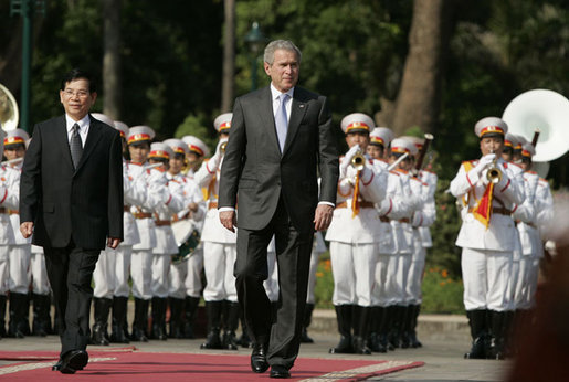 President George W. Bush and Viet President Nguyen Minh Triet review the honor guard Friday, Nov. 17, 2006, during the arrival ceremony at the Presidential Palace in Hanoi. White House photo by Paul Morse