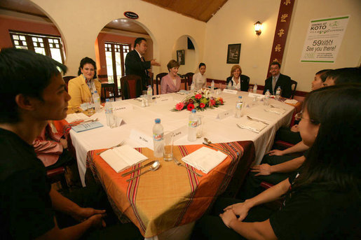 Mrs. Laura Bush is welcomed to a roundtable and lunch at the KOTO Restaurant in Hanoi by Jimmy Pham, Founder and Project Director of Know One, Teach One, a grass-roots humanitarian program designed to train Hanoi youth in the service industry. White House photo by Shealah Craighead