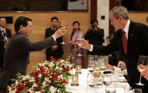 "President George W. Bush exchanges toasts with Viet President Nguyen Minh Triet during a State Banquet Friday, Nov. 17, 2006, at the International Convention Center in Hanoi. President Bush told his host, ""Vietnam is a country that's taking its rightful place as a strong and vibrant nation,"" adding he hoped its people know they have the friendship of the American people. White House photo by Paul Morse"