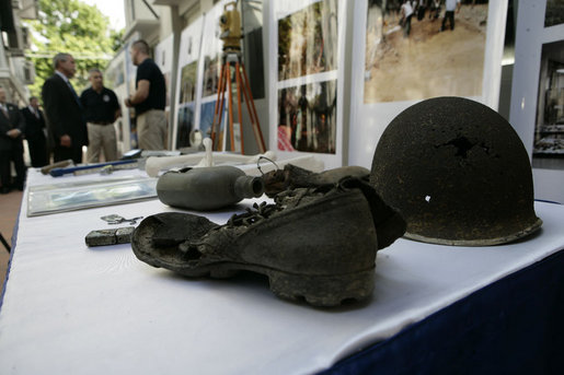 A recovered helmet, canteen and shoe are among articles on display Saturday, Nov. 18, 2006, as President George W. Bush visits the Joint POW/MIA Accounting Command in Hanoi. White House photo by Eric Draper