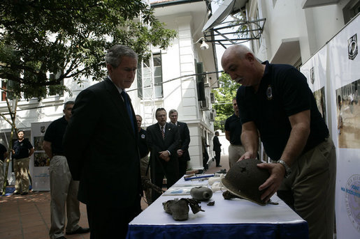 Forensic archaeologist Dr. Bradley Sturm briefs President George W. Bush during a visit Saturday, Nov. 18, 2006, to the POW/MIA Accounting Command in Hanoi. White House photo by Eric Draper