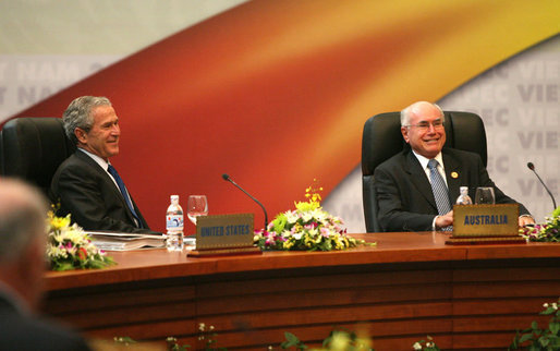 President George W. Bush shares a light moment with Prime Minister John Howard of Australia as they participate in the first retreat of the APEC leaders Saturday, Nov. 18, 2006, at the National Conference Center in Hanoi. White House photo by Eric Draper