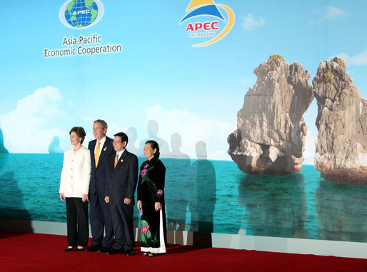 President George W. Bush and Mrs. Laura Bush stand with Viet President Nguyen Minh Triet and Mrs. Tran Thi Kim Chi after arriving Saturday, Nov. 18, 2006, at the National Convention Center in Hanoi for the APEC gala dinner and cultural performance. White House photo by Eric Draper