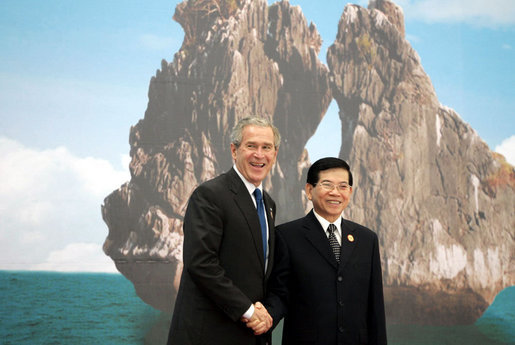 President George W. Bush and President Nguyen Minh Triet of Vietnam share in a photo opportunity Saturday, Nov. 18, 2006, at the National Conference Center in Hanoi prior to the start of the first retreat of the 2006 APEC Summit. White House photo by Paul Morse