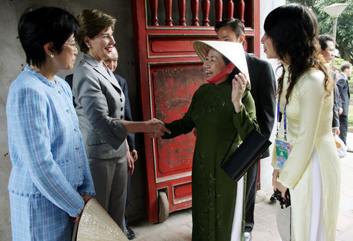 Mrs. Laura Bush is greeted as she arrives at the Temple of Literature in Hanoi Saturday, Nov. 18, 2006, for a tour with the spouses of APEC leaders. White House photo by Shealah Craighead