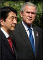 President George W. Bush and Prime Minister Shinzo Abe of Japan talk with the media during a photo opportunity Saturday, Nov. 18, 2006, following their lunch at the Sheraton Hanoi hotel. White House photo by Eric Draper