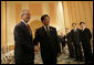 "President George W. Bush is greeted by President Hu Jintao of China at the Hanoi Daewoo Hotel in Hanoi after his arrival Sunday, Nov. 19, 2006, for bilateral talks. President Bush told President Hu, ""China is a very important nation, and the United States believes strongly that by working together, we can help solve problems."" White House photo by Eric Draper"