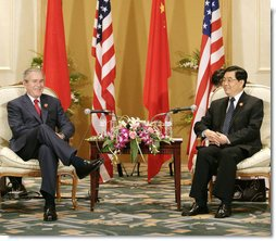 President George W. Bush and President Hu Jintao of China pause for photos after their bilateral talks Sunday, Nov. 19, 2006, at the Hanoi Daewoo Hotel in Hanoi. White House photo by Eric Draper