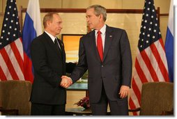"President George W. Bush and President Vladimir Putin of Russia exchange handshakes Sunday, Nov. 19, 2006, at the Sheraton Hanoi after their two countries signed agreements supporting Russia's accession into the World Trade Organization. Said President Bush afterward, ""This is a good agreement for the United States. And it's an equally important agreement for Russia. And it's a good agreement for the international trading community."" White House photo by Eric Draper"