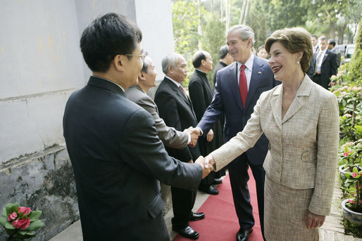 Mrs. Laura Bush is greeted as she and President George W. Bush arrive for church services Sunday, Nov. 19, 2006, at Cua Bac Church in Hanoi. White House photo by Eric Draper