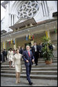 "President George W. Bush and Mrs. Laura Bush leave the Cua Bac Church in Hanoi Sunday, Nov. 19, 2006, following morning services. The President stopped for a brief statement afterward during which he said, ""A whole society is a society which welcomes basic freedom, and there's no more basic freedom than the freedom to worship."" White House photo by Eric Draper"