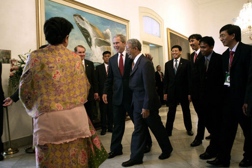 President George W. Bush greets participants as he heads to a roundtable discussion Monday, Nov. 20, 2006, at the Bogor Palace in Bogor, Indonesia. White House photo by Eric Draper
