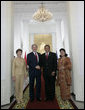 President George W. Bush and Mrs. Laura Bush are greeted by President Susilo Bambang Yudhoyono of Indoniesia and Herawati Yudhoyono at the Presidential Palace in Bogor, Indonesia, after arriving in the country for a six-hour visit Monday, Nov. 20, 2006.  White House photo by Eric Draper