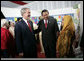 President George W. Bush and Indonesian President Susilo Bambang Yudhoyono talk with an educator Monday, Nov. 20, 2006, during a drop-by educational event at the Bogor Palace in Bogor, Indonesia. White House photo by Eric Draper