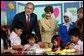 President George W. Bush and Mrs. Laura Bush pose with 6th graders during a drop-by education event Monday, Nov. 20, 2006, at the Bogor Palace in Bogor, Indonesia. White House photo by Eric Draper