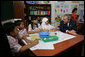 President George W. Bush talks with students at Papandaya Public Elementary School in Bogor Palace, Indonesia, Monday, Nov. 20, 2006. White House photo by Shealah Craighead