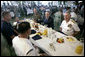 President George W. Bush joins Admiral William J. Fallon, right, Commander of the U.S. Pacific Command, and other military personnel during a breakfast Tuesday, Nov. 21, 2006, at the Officers Club at Hickam Air Force Base in Honolulu, Hawaii. White House photo by Eric Draper