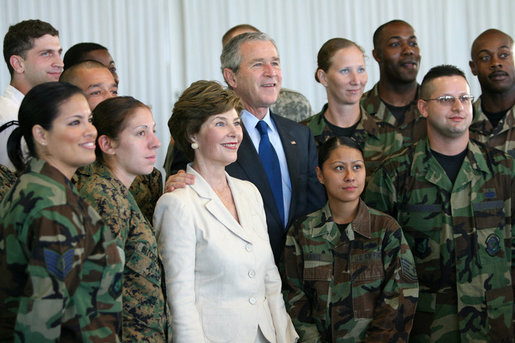 President George W. Bush and Laura Bush pose for photos with military personnel during a breakfast Tuesday, Nov. 21, 2006, at the Officers Club at Hickam Air Force Base in Honolulu, Hawaii. White House photo by Eric Draper