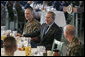 President George W. Bush visits with military personnel during a breakfast Tuesday, Nov. 21, 2006, at the Officers Club at Hickam Air Force Base in Honolulu, Hawaii. White House photo by Paul Morse