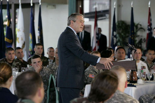 President George W. Bush delivers his remarks following his breakfast meeting with U.S. military troops at Hickam Air Force Base, Tuesday, Nov. 21, 2006 in Honolulu, Hawaii. President Bush thanked the group for their warm reception and for their service and sacrifice to the nation. White House photo by Paul Morse