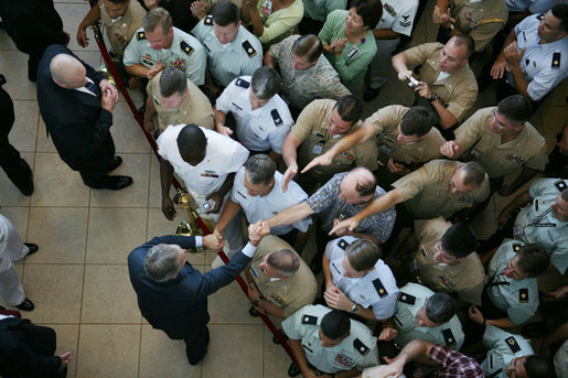 President George W. Bush is seen reaching into a crowd of military personnel to shake hands following his remarks at a breakfast meeting with U.S. military troops at Hickam Air Force Base, Tuesday. Nov. 21, 2006 in Honolulu, Hawaii. White House photo by Paul Morse