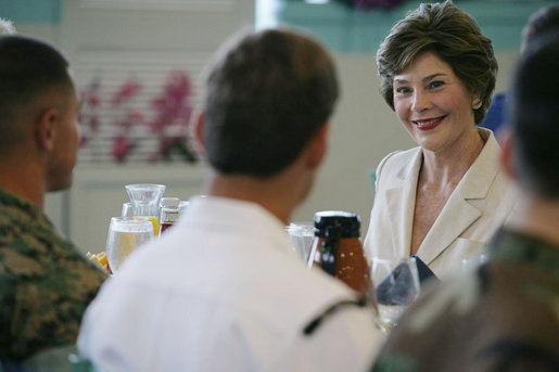 Mrs. Laura Bush visits during breakfast with military personnel Tuesday, Nov. 21, 2006, at the Officers Club at Hickam Air Force Base in Honolulu, Hawaii. White House photo by Shealah Craighead