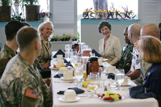 Mrs. Laura Bush is joined by Mary Fallon, left, wife of Navy Admiral William J. Fallon the Commander of the U.S. Pacific Command, during breakfast with military personnel Tuesday, Nov. 21, 2006, at the Officers Club at Hickam Air Force Base in Honolulu, Hawaii. White House photo by Shealah Craighead