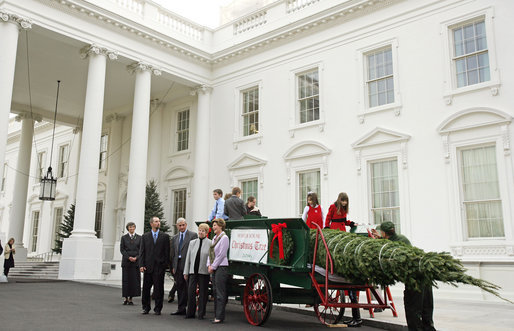 Mrs. Laura Bush stands with the Botek family of Lehighton, Pa., as she receives the official White House Christmas tree on the North Portico Monday, Nov. 27, 2006. The Botek family owns Crystal Springs Tree Farm and donated the 18-foot Douglas fir tree. White House photo by Shealah Craighead