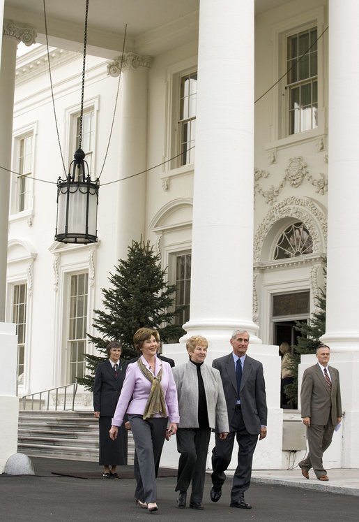 Mrs. Laura Bush walks with Margaret and Francis Botek of Lehighton, Pa., during the arrival of the official White House Christmas tree on the North Portico Monday, Nov. 27, 2006. The Botek family owns Crystal Springs Tree Farm and donated the 18-foot Douglas fir tree. White House photo by Shealah Craighead
