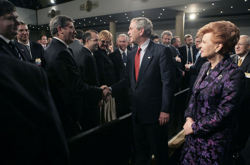 President George W. Bush greets the audience after delivering remarks Tuesday, Nov. 28, 2006, with Latvia President Vaira Vike-Freiberga at Latvia University in Riga. White House photo by Eric Draper