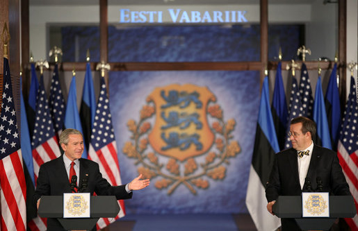 "President George W. Bush smiles as he joins President Toomas Hendrik Ilves of Estonia, at the National Bank of Estonia in Tallinn Tuesday, Nov. 28, 2006, for a joint press availability. President Bush told his counterpart, ""I'm proud to be the first sitting American President to visit Estonia."" White House photo by Paul Morse"