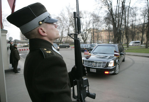 An honor guard stands at attention as the limousine carrying President George W. Bush arrives Tuesday, Nov. 28, 2006, at Riga Castle in Riga, Latvia, where the President met with Latvian President Vaira Vike-Freiberga. White House photo by Eric Draper