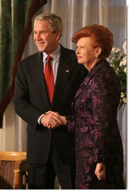 President George W. Bush and Latvia's President Vaira Vike-Freiberga exchange handshakes Tuesday, Nov. 28, 2006, during their meeting at Riga Castle in Riga, Latvia. White House photo by Eric Draper