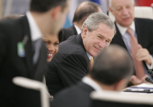 President George W. Bush and Secretary of State Condoleezza Rice share a light moment with NATO heads of state and officials Wednesday, Nov. 29, 2006, during the 2006 NATO Summit in Riga, Latvia. White House photo by Paul Morse