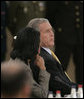 President George W. Bush confers with Secretary of State Condoleezza Rice Wednesday, Nov. 29, 2006, during the 2006 NATO Summit in Riga, Latvia. White House photo by Paul Morse