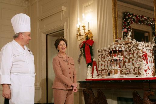 Mrs. Laura Bush and former chef Roland Mesnier discuss the gingerbread White House with the press in the State Dining Room Thursday, Nov. 30, 2006. The house consists of more than 300 pounds of dark chocolate and gingerbread. White House photo by Shealah Craighead