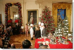 Mrs. Laura Bush and White House Chef Cris Comerford, center, explain the holiday reception menu to the press in the State Dining Room Thursday, Nov. 30, 2006. White House photo by Shealah Craighead