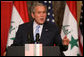 President George W. Bush responds to a question Thursday, Nov. 30, 2006, during a joint press availability in Amman, Jordan, with Iraq's Prime Minister Nouri al-Maliki. White House photo by Paul Morse