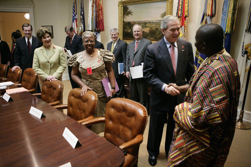 President George W. Bush welcomes Cyriaque Yapo Ako, executive director of the Reseau Ivoirien des Organisations de PVVIH in Cote d'Ivoire, Africa, to the White House World AIDS Day meeting hosted by President Bush and Laura Bush, Friday, Dec. 1, 2006. Participants included supporters of the President's Emergency Plan for AIDS Relief (PEPFAR), which is the largest international health initiative in history dedicated to a single disease. Angelina Magaga of the Light and Courage Center Trust of Botswana, Africa, is seen center. White House photo by Eric Draper