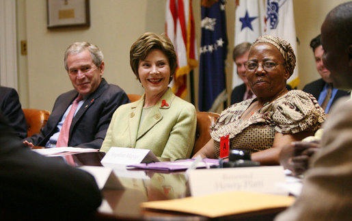 President George W. Bush and Laura Bush speak with their guests at a meeting on World AIDS Day in the Roosevelt Room at the White House, Friday, Dec. 1, 2006, who support the President's Emergency Plan for AIDS Relief (PEPFAR), which is the largest international health initiative in history dedicated to a single disease. Angelina Magaga, Center Coordinator for the Light and Courage Center Trust in Botswana, Africa, is seen at right. White House photo by Eric Draper