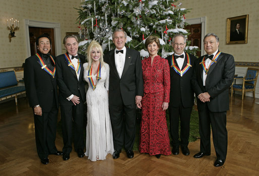 "President George W. Bush and Mrs. Laura Bush stand with the Kennedy Center honorees in the Blue Room of the White House during a reception Sunday, Dec. 3, 2006. From left, they are: singer and songwriter William ""Smokey"" Robinson; musical theater composer Andrew Lloyd Webber; country singer Dolly Parton; film director Steven Spielberg; and conductor Zubin Mehta. White House photo by Eric Draper"