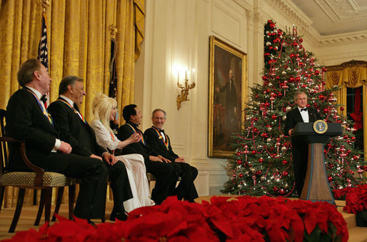 "President George W. Bush speaks during a reception for the Kennedy Center honorees in the East Room Sunday, Dec. 3, 2006. They are, from left: musical theater composer Andrew Lloyd Webber; conductor Zubin Mehta; country singer Dolly Parton; singer and songwriter William ""Smokey"" Robinson; and film director Steven Spielberg. White House photo by Shealah Craighead"