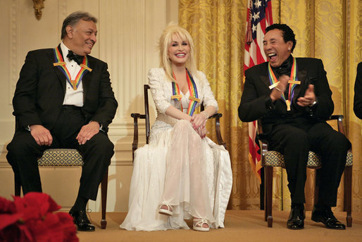 "Conductor Zubin Mehta laughs with singers Dolly Parton and William ""Smokey"" Robinson during a reception for the Kennedy Center honorees in the East Room Sunday, Dec. 3, 2006. White House photo by Eric Draper"