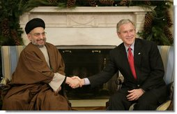 "President George W. Bush welcomes Sayyed Abdul-Aziz Al-Hakim, Leader of the Supreme Council for the Islamic Revolution in Iraq, to the White House Monday, Dec. 4, 2006. Said the President, ""I appreciate so very much His Eminence's commitment to a unity government. I assured him the United States supports his work and the work of the Prime Minister to unify the country."" White House photo by Eric Draper"