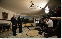 "President George W. Bush and Robert Gates, the President's nominee for Secretary of Defense, stand before the press Tuesday morning, Dec. 5, 2006, in the Diplomatic Reception Room of the White House. Said the President, ""Bob Gates will be a fine Secretary of Defense. I hope for a speedy confirmation so he can get sworn in and get to work."" White House photo by Eric Draper"