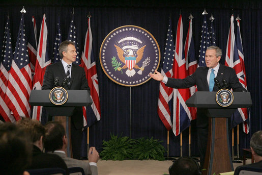 President George W. Bush responds to a question during a joint news conference with British Prime Minister Tony Blair, Thursday, Dec. 7, 2006, in the Dwight D. Eisenhower Executive Office Building.