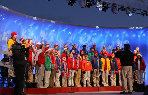 Members of The Singing Angels choir, under the direction of Charles Eversole, perform Thursday evening, Dec. 7, 2006, during the 2006 Christmas Pageant of Peace and lighting of the National Christmas Tree on the Ellipse in Washington, D.C. White House photo by Kimberlee Hewitt
