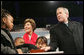 President George W. Bush and Laura Bush are joined by Junior Rangers from the National Park Service program Thursday evening, Dec. 7, 2006, as they press the switch to light the National Christmas Tree on the Ellipse in Washington, D.C. White House photo by Kimberlee Hewitt