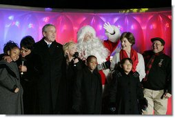 President George W. Bush and Laura Bush join entertainers Eartha Kitt, left, and Cathy Rigby, center, along with Santa Claus, invited children and The Singing Angels choir director Charles Eversole, right, on stage Thursday, Dec. 7, 2006, at the 2006 Christmas Pageant of Peace and the 83rd lighting of the National Christmas Tree on the Ellipse in Washington, D.C.  White House photo by Kimberlee Hewitt