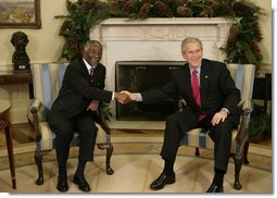 "President George W. Bush welcomes Thabo Mbeki, President of South Africa, to the Oval Office Friday, Dec. 8, 2006. The leaders talked about a wide range of subjects, according to the President, "".including Darfur and the need for South Africa and the United States and other nations to work with the Sudanese government to enable a peacekeeping force into that country to facilitate aid and save lives.""  White House photo by Paul Morse"